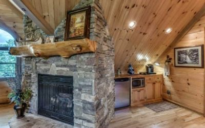 Fireplace in loft of log home
