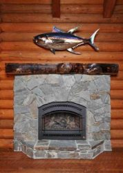 Stone fireplace with fish above mantle