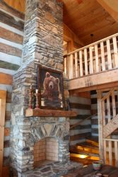 Stone fireplace with bear print above mantle