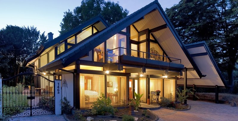 Timber frame house at night