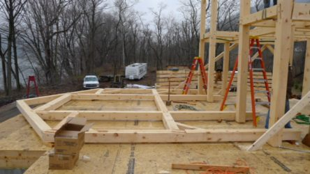 Timber frame sections on the ground