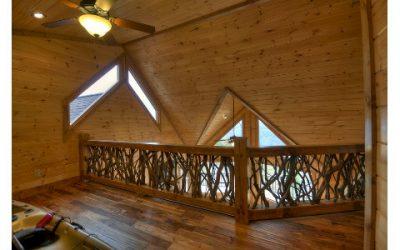 Twig railing in loft of log cabin