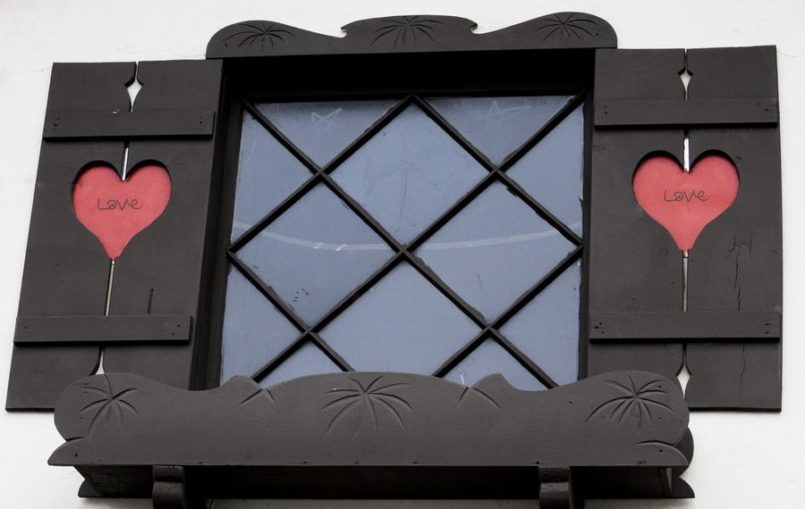 Brown shutters with red hearts