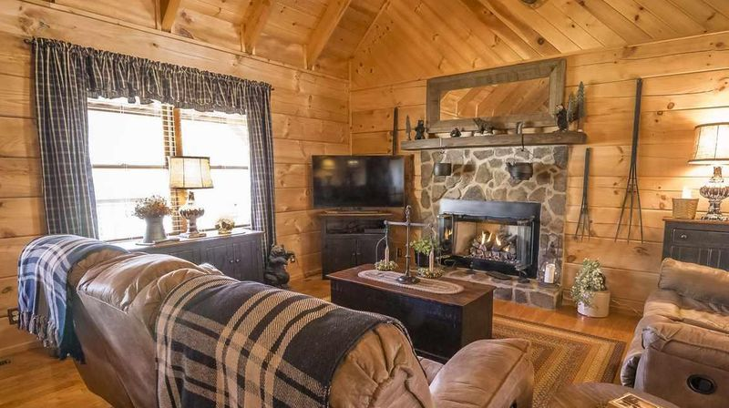 Blue curtains that match accessories in log cabin living room