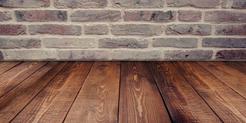 Wood laminate against a brick wall
