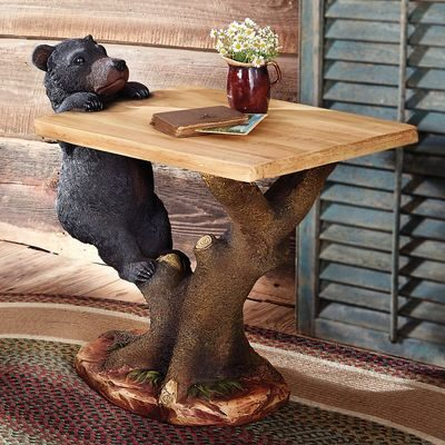 Glass table top on accent table with bear climbing up onto it, a rustic cabin furniture accent