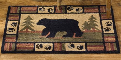 adirondack rug with bear and pines in background