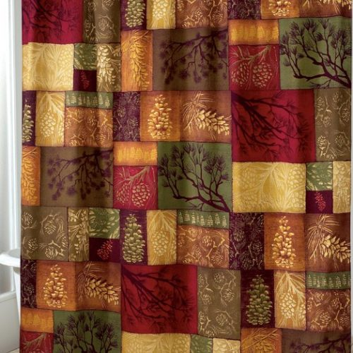 Blocks of colors and pines give the rustic shower curtain a block quilt appearance.