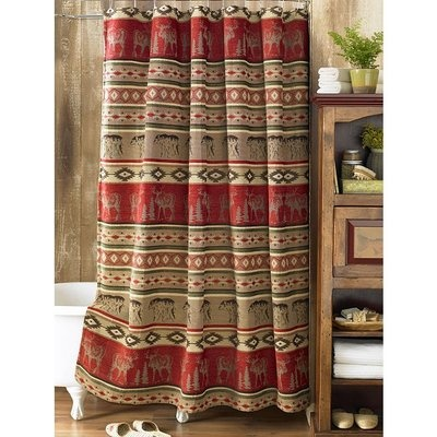 shower curtain with images of strolling bears and moose framed by geometric patterns