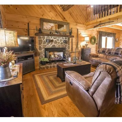 Rustic cabin furniture in living room area of a log cabin