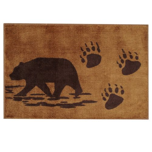 brown wandering bear and bear tracks on tan rug