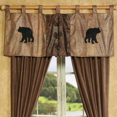 Brown curtains and valance with black bears