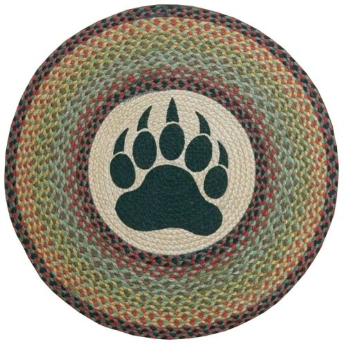 large black bear paw silhouette surrounded by a colorful braided border rug