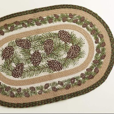 Beige braided rug with pine cones