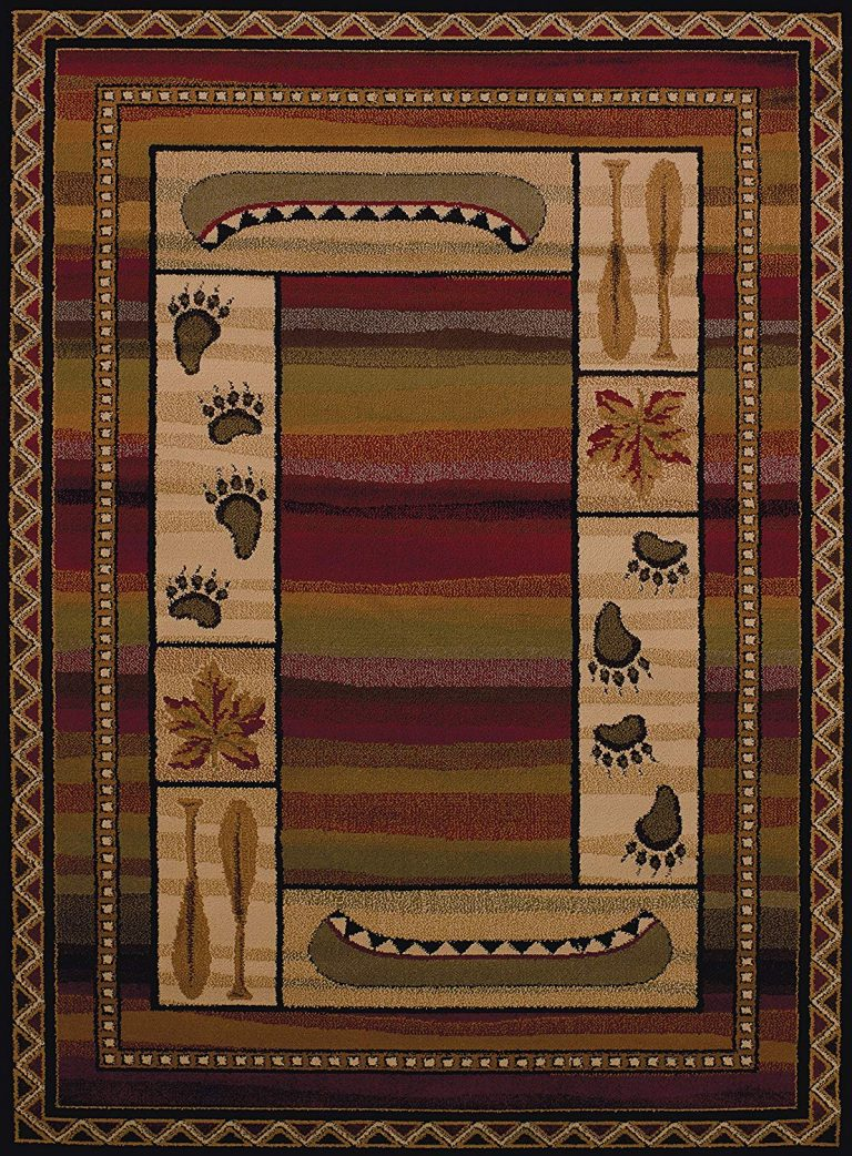 Rug features canoes, bear tracks and leaves