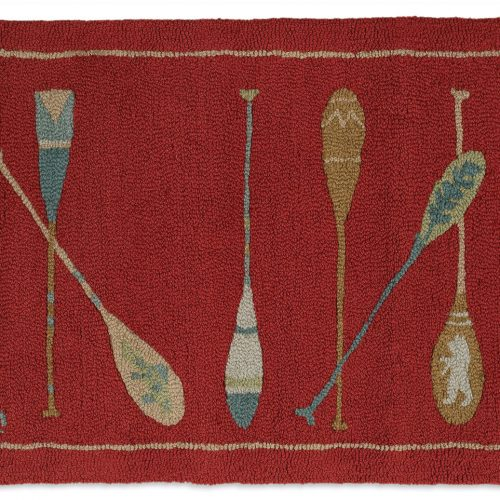 painted canoe paddles on a crimson rug