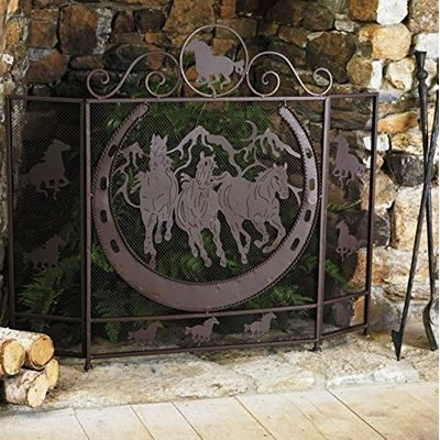 Black metal fireplace screen with horses