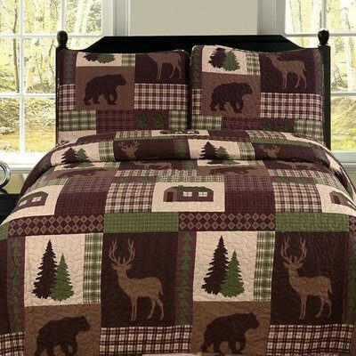 Pretty quilt in browns with deer theme bedding