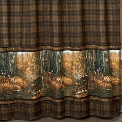 Brown plaid curtains with deer scene at the bottom