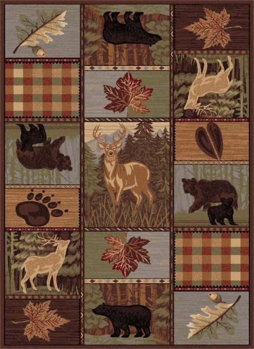 rug with look of quilt and pictures of deer, bears, paw prints and falling leaves.