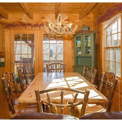 Pretty table and chairs in dining area of log home