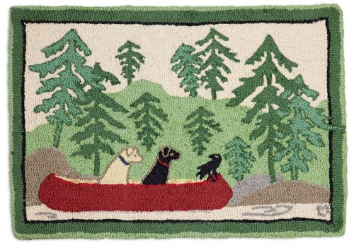 green rug with two dogs out on the lake in red canoe