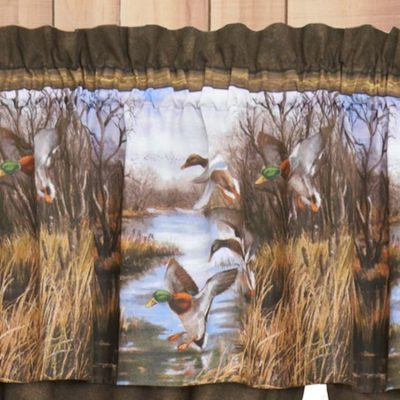 Valance with flying ducks landing on a pond