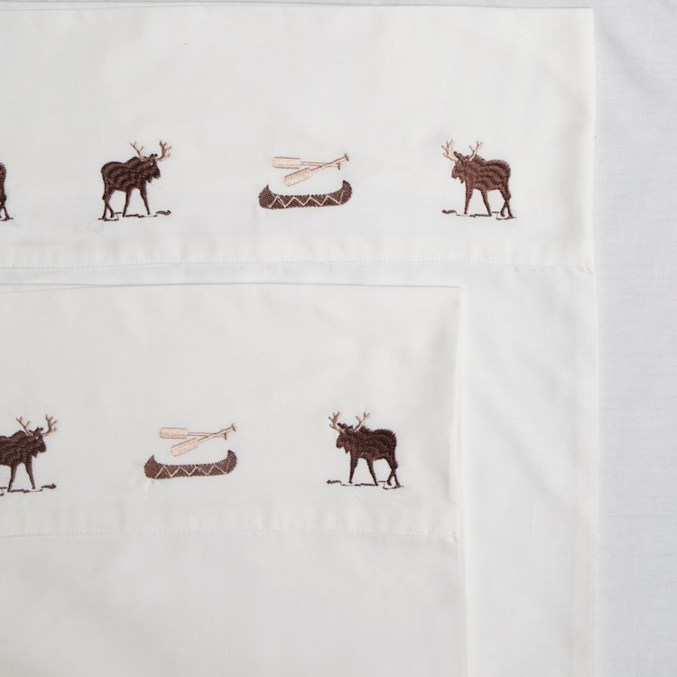 Sheets with embroidered moose and canoes