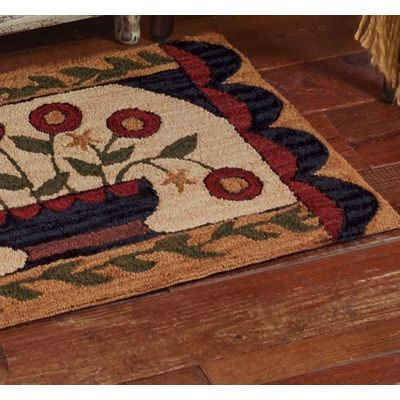 Pretty hand hooked rug with floral design