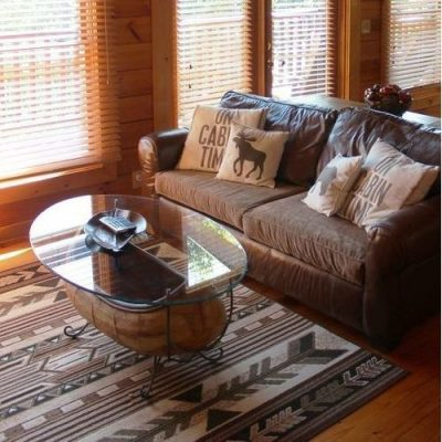 Log homes sitting area with pretty cabin rug
