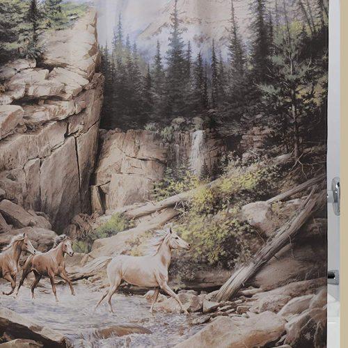 shower curtain featuring three horses dashing through a mountain stream in a canyon