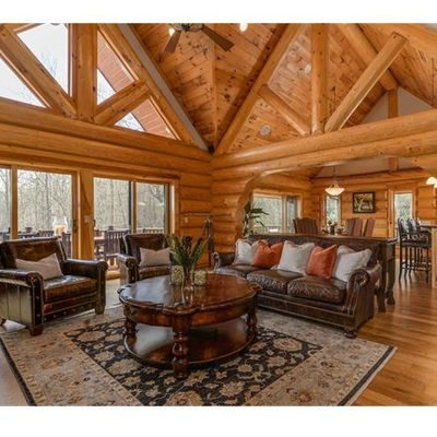 Living room area with furniture in a log home