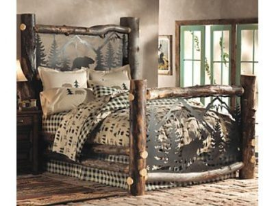 Log bed with metal scene on headboard