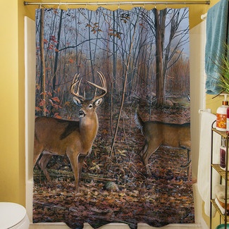 shower curtain depicting a buck and his doe, traveling through a wooded area