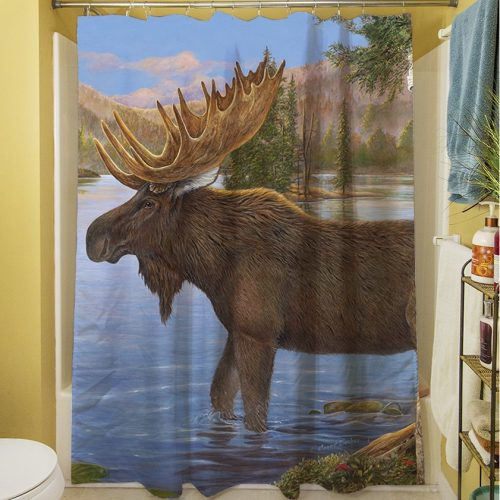 shower curtain with mature bull moose in the wild, standing in a lake, with mountains and pine trees in the background.