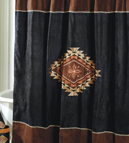 shower curtain embroidered with a Native American-influenced medallion
