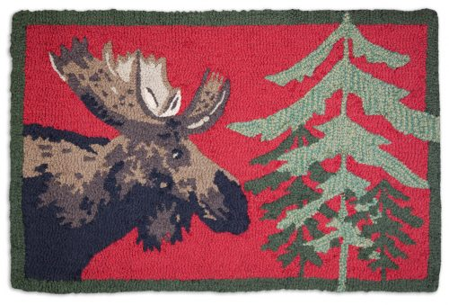 moose and pines on bright red rug
