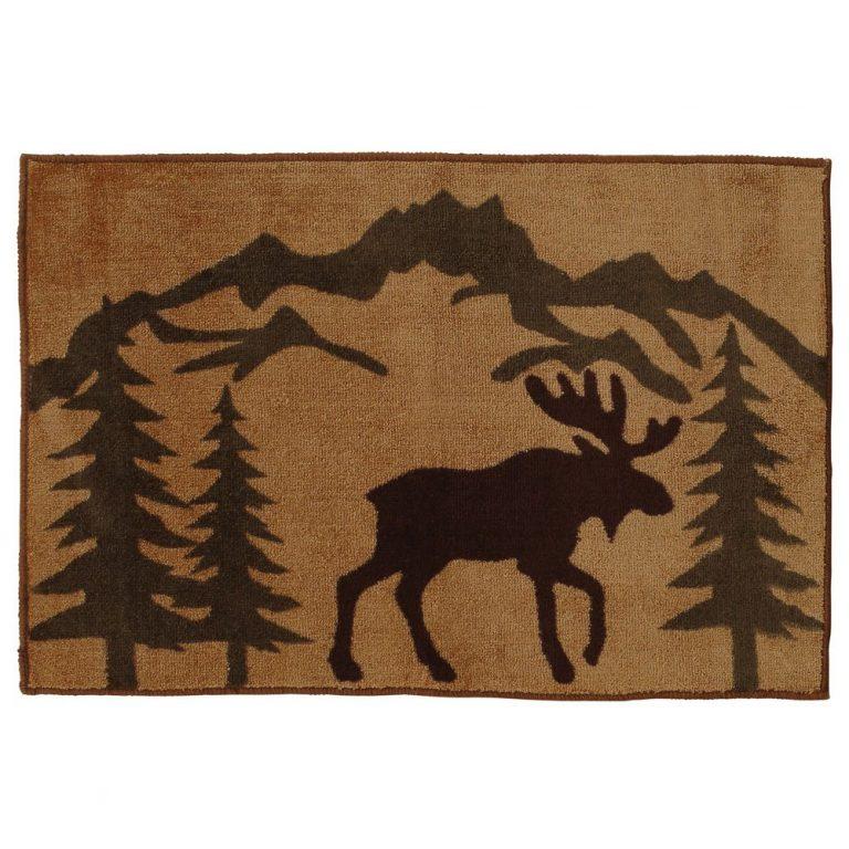 moose and pines on tan rug