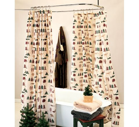 Cute silhouettes of bears, moose, squirrels, porcupines, fish and pine trees adorn this shower curtain