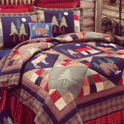 Colorful comforter with northwoods theme, animals and trees