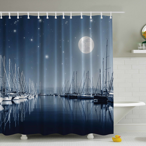 shower curtain picturing sailboats in marina at full moon