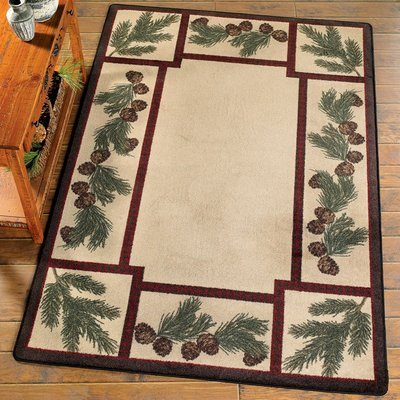 Plush rug with pine cones on border