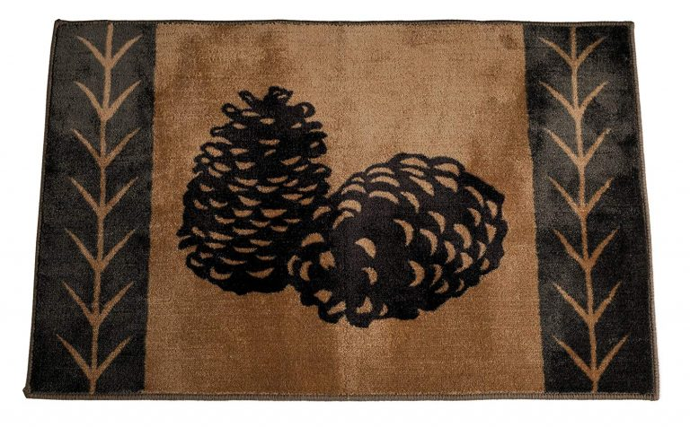 tan rug with brown pinecones