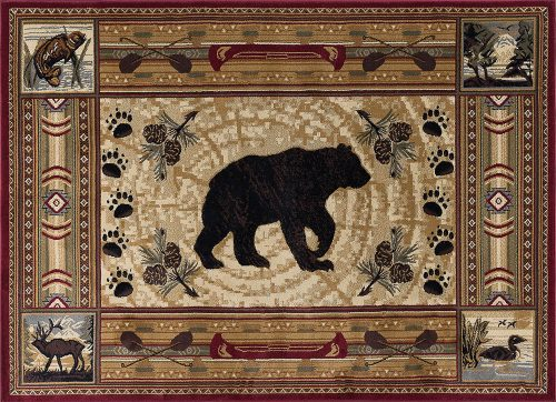 rug with a large bear silhouette that is surrounded by pine cones, bear tracks and canoes.