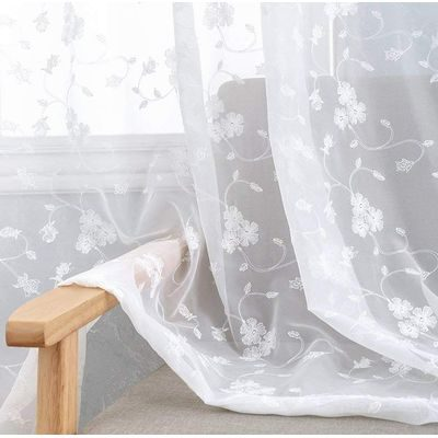 Sheer curtains with floral design