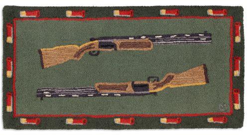 two shotguns and shells on green rug
