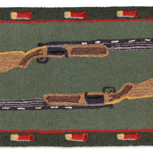 two shotguns and shells on green rug