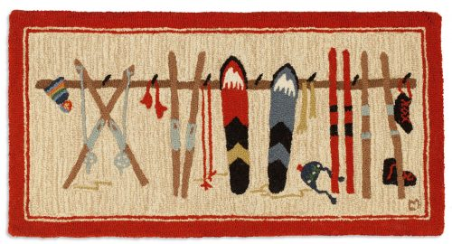 rug with skis, ski poles and snow boards on rack