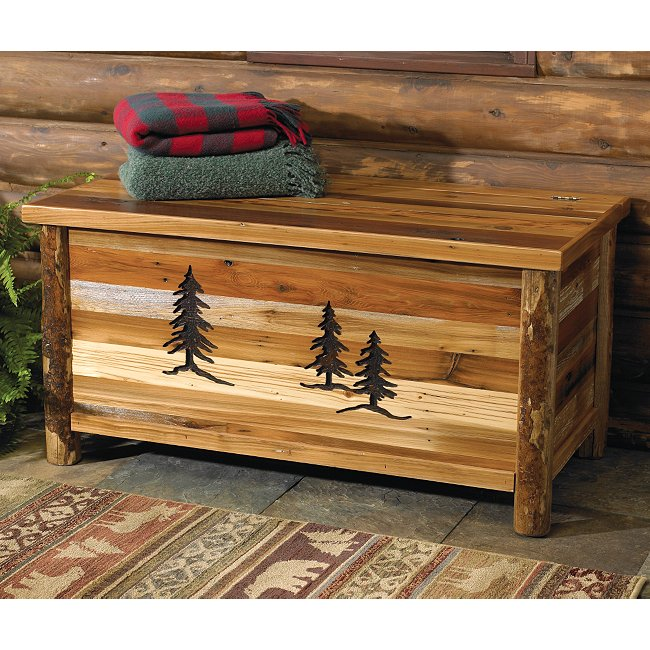 Carved trees on blanket chest