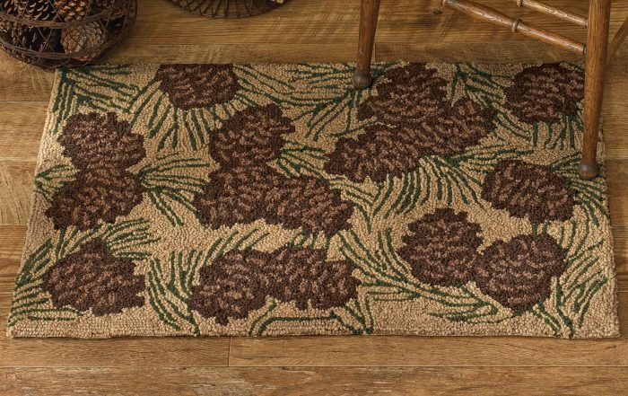 rug with pine cones and boughs on a light brown background